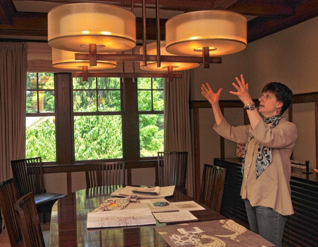 Karen Dzendolet talks about lighting in a home she designed in Amherst. Carol Lollis Photo - Gazette